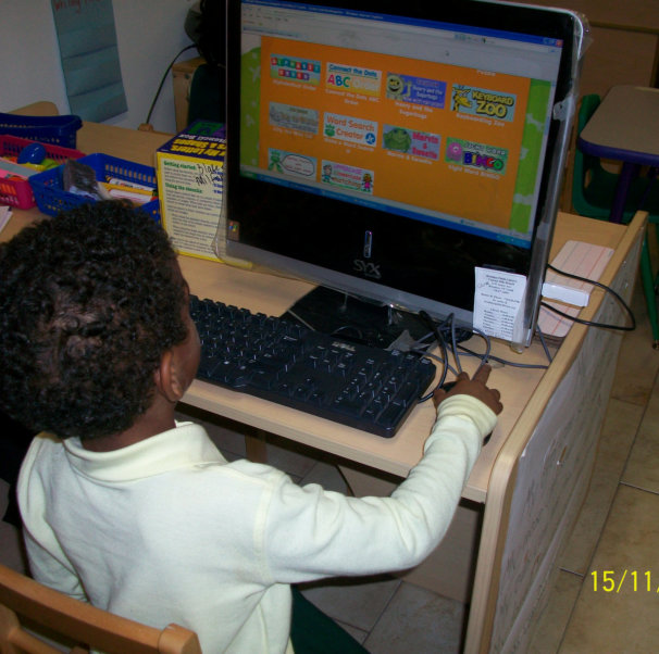 kid playing in a computer